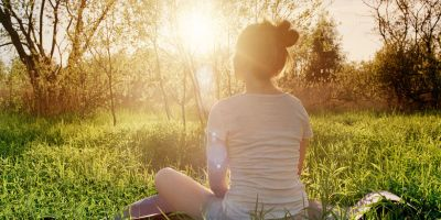 landscape-1490180515-young-woman-sitting-in-yoga-position-enjoying-sunset-in-nature - 400